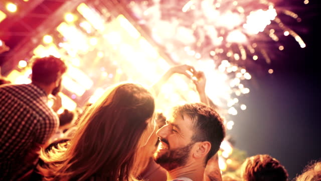 couple enjoying fireworks display. - firework display stock videos & royalty-free footage