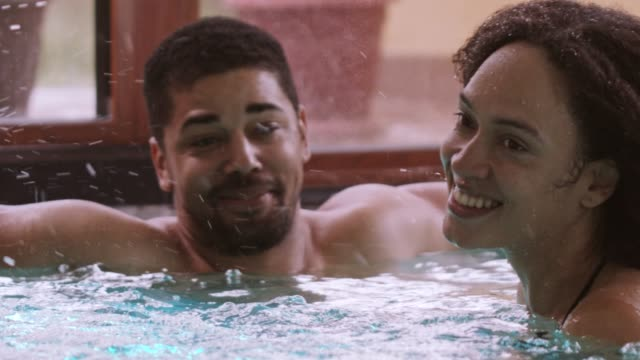 Couple enjoying hydrotherapy at spa