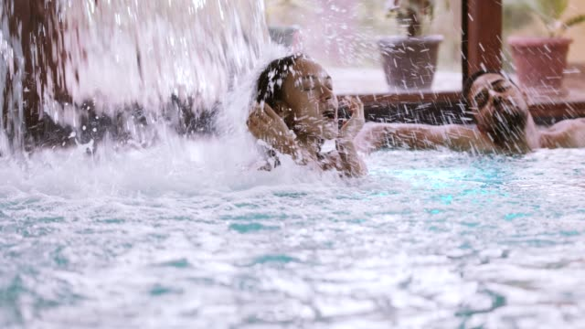 couple enjoying hydrotherapy treatment - hydrotherapy stock videos & royalty-free footage