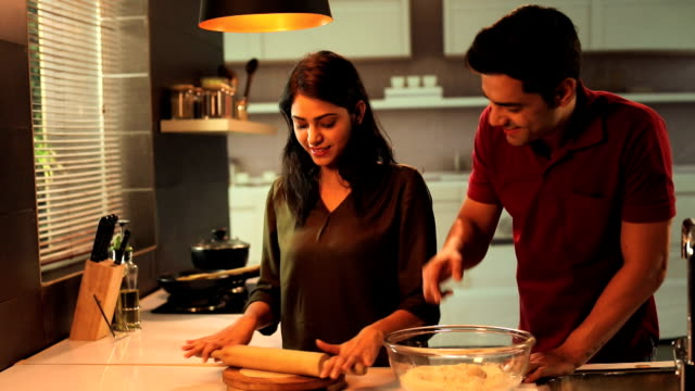 couple enjoying in the kitchen, delhi, india - mischief stock videos & royalty-free footage