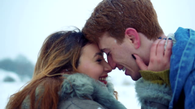 couple enjoying love in winter nature - redhead stock videos & royalty-free footage