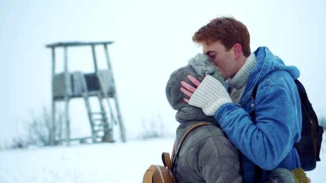 couple enjoying love in winter nature - ventenne video stock e b–roll