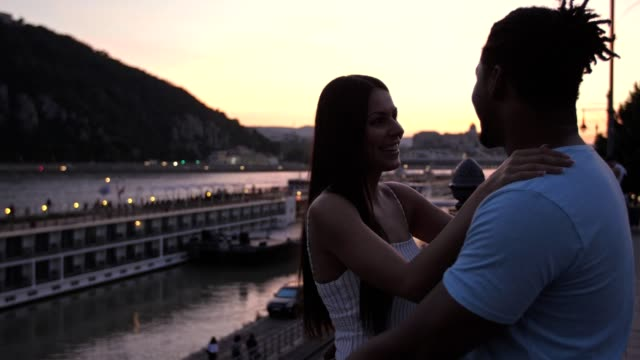 couple enjoying sunset in budapest - afro caribbean ethnicity stock videos and b-roll footage