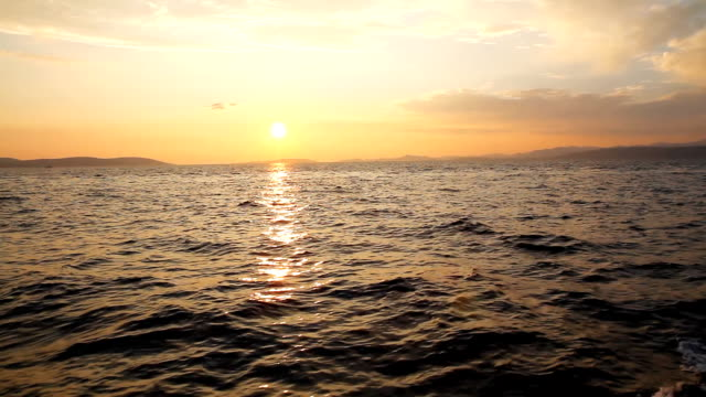 stockvideo's en b-roll-footage met couple enjoying the sailing at sunset - mid volwassen mannen