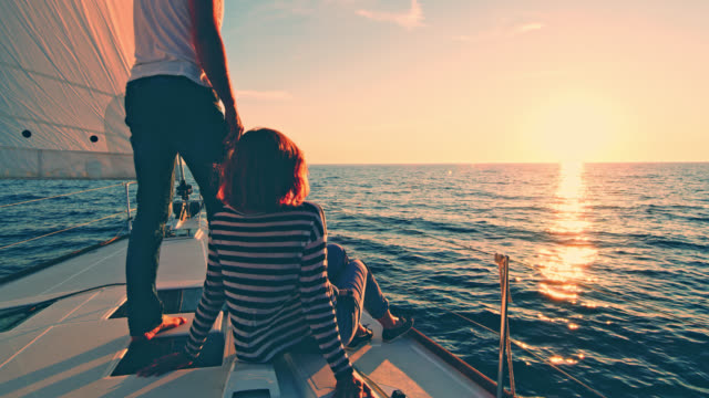 WS Couple enjoying the view of a sunset on a boat