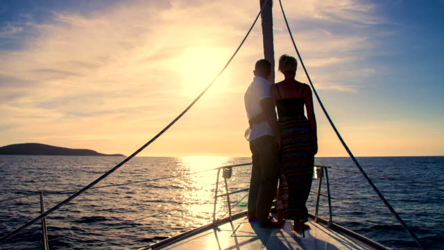 ws couple enjoying view from the bow - yachting stock videos & royalty-free footage