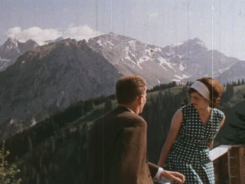 """1964 - couple enjoying view of tyrolean mountains, cows grazing on mountainside, cowbells ringing - """"archive farms"""" stock videos & royalty-free footage"""