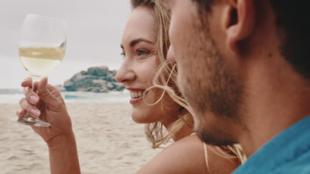 couple enjoying wine at beach during weekend - white wine stock videos & royalty-free footage