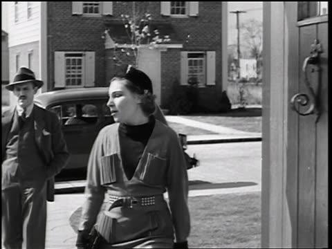 b/w 1935 couple entering thru doorway of house / educational - 1935 stock videos & royalty-free footage