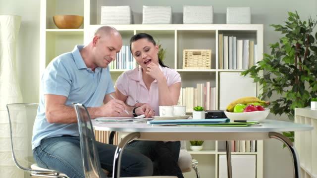 HD DOLLY: Couple Examining Home Finances