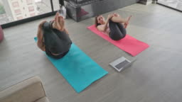 Couple exercising through YouTube tutorials