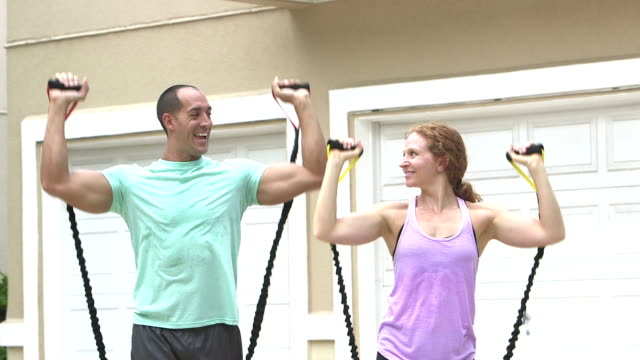 couple exercising together with resistance bands - mid adult couple stock videos & royalty-free footage