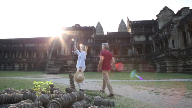 couple explore ancient ruins of angkor wat - pct stock videos and b-roll footage