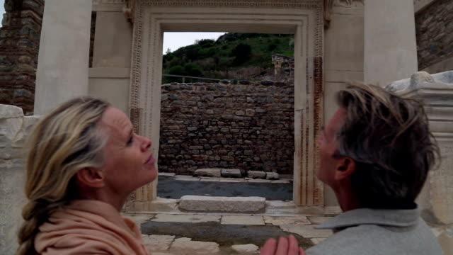 Couple explore ruins of ancient Greek civilization