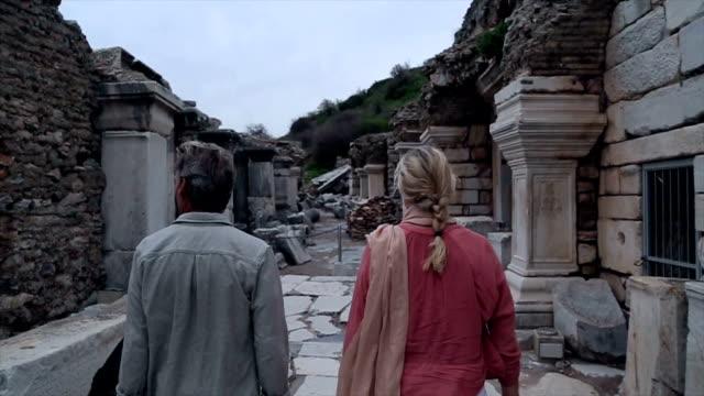 couple explore ruins of ancient greek civilization - izmir stock videos & royalty-free footage
