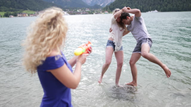 couple falling into lake - squirt gun stock videos and b-roll footage