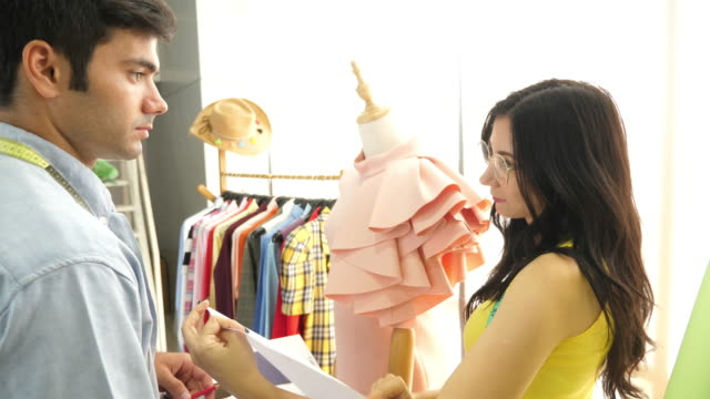 couple fashion designers are discussing - sewing stock videos & royalty-free footage