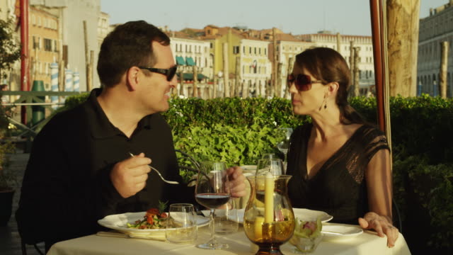 ms couple feeding each other in outdoor restaurant / venice,veneto - italian culture stock videos & royalty-free footage