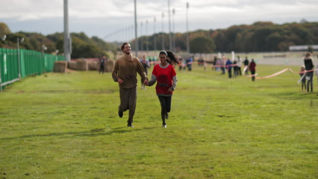 couple finishing race together - obstacle course stock videos & royalty-free footage