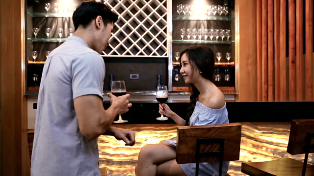 couple flirting at bar - embarrassment stock videos & royalty-free footage