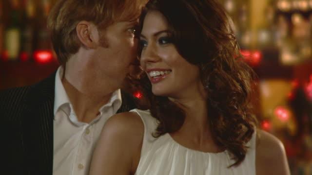 cu tu couple flirting in bar, jacksonville, florida, usa - 談笑する点の映像素材/bロール