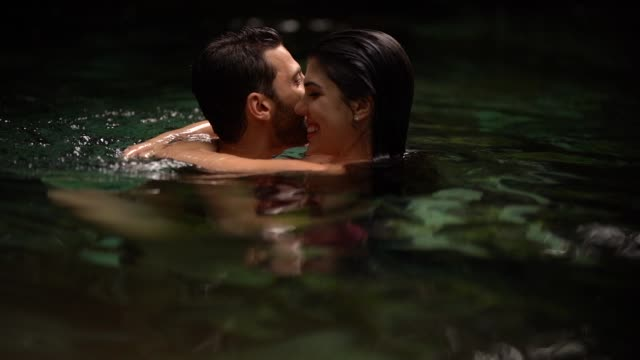couple floating on river - lagoon stock videos & royalty-free footage