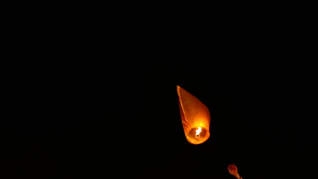 couple flying paper lantern in diwali festival, delhi, india - lantern stock videos & royalty-free footage