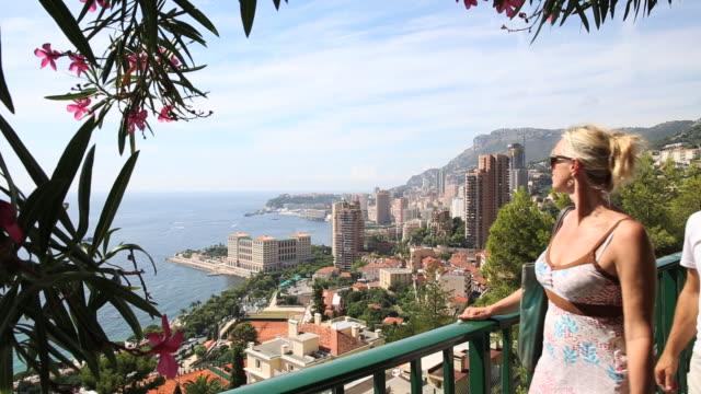 Couple follows walkway, takes pic of Monte Carlo skyline