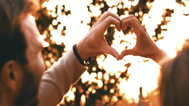 couple forming heart shape with hands - mid adult couple stock videos & royalty-free footage