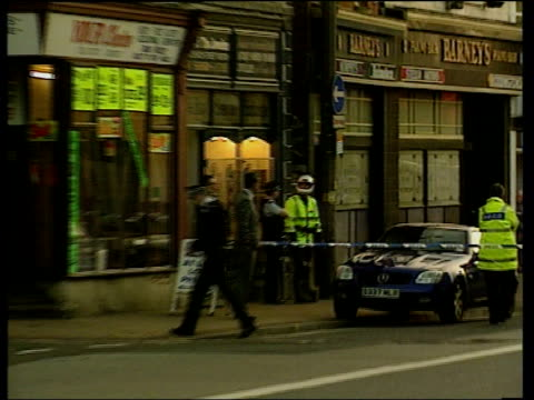 vídeos y material grabado en eventos de stock de couple found murdered in jewellers shop granada lancashire preston street zoom in to jewellers shop with police outside where mohammed and bilquis... - lancashire
