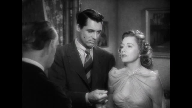 1941 couple (irene dunne & cary grant) get re-married, recite wedding vows - priest stock videos & royalty-free footage