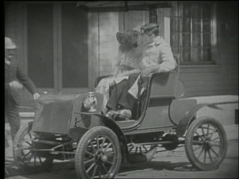 b/w couple gets into fold-out seat in car with other couple / 1900's - other stock videos & royalty-free footage