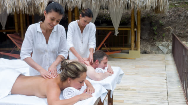 Couple getting a back massage at the spa