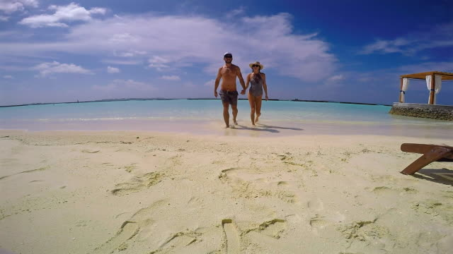 couple getting out of the water, maldives - one piece swimsuit stock videos & royalty-free footage