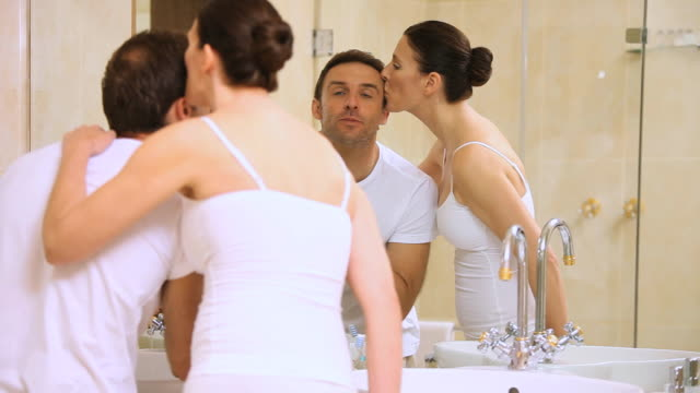 MS Couple getting ready in bathroom at home / Cape Town, Western Cape, South Africa
