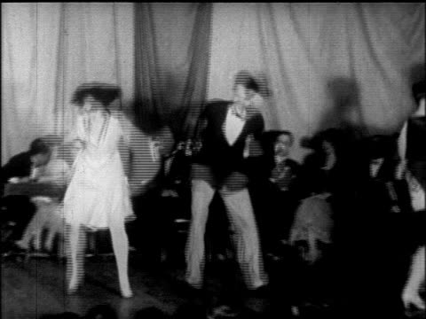 B/W 1925 couple going crazy dancing Charleston at dance marathon / Chicago / newsreel