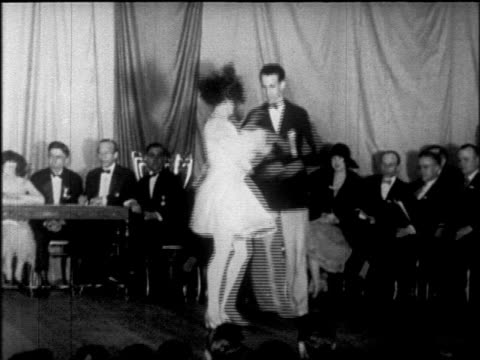b/w 1925 couple going crazy dancing charleston at dance marathon / chicago / newsreel - 1925 stock videos & royalty-free footage
