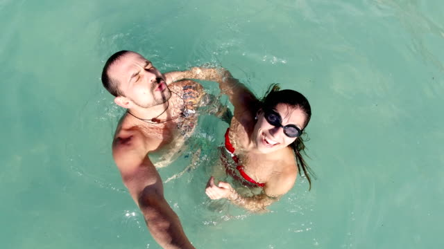 couple happy at the sea making selfies - photographing stock videos & royalty-free footage