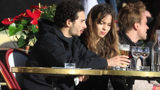 couple has a drink on a cafe terrace at aperitif time on the day of the reopening of the terraces in france on may 19, 2021 in paris, france. the... - dating stock videos & royalty-free footage