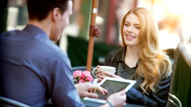 couple have coffee or latte at outdoor cafe - young women stock videos & royalty-free footage