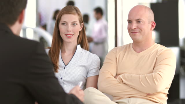 hd: couple having a conversation in the bank - insurance agent stock videos & royalty-free footage