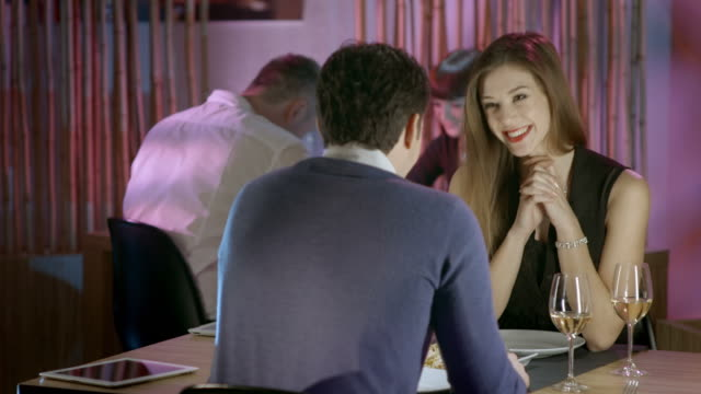 hd: couple having a first date in the restaurant - first occurrence stock videos & royalty-free footage