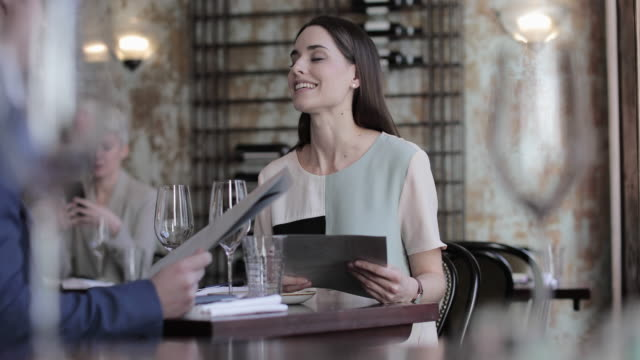 couple having a meal in a restaurant - menu stock videos & royalty-free footage