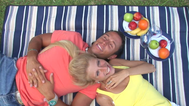 hd: couple having a picnic - lying on side stock videos & royalty-free footage