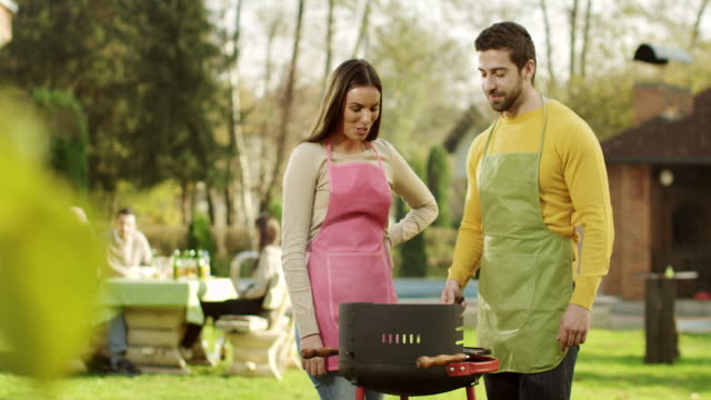 Couple having barbecue
