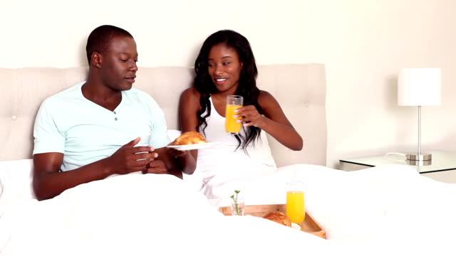 couple having breakfast in bed - black stock videos & royalty-free footage