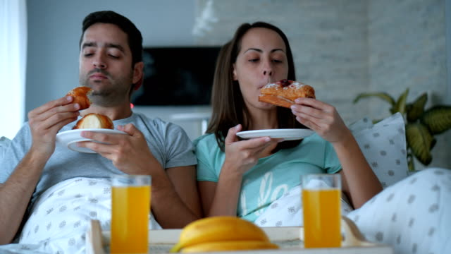 couple having breakfast in bed - cream cake stock videos & royalty-free footage