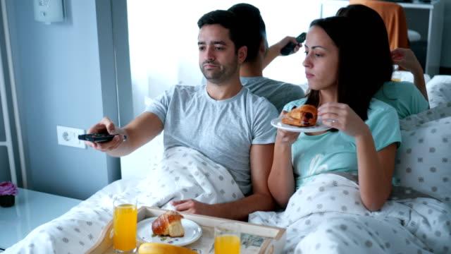 couple having breakfast in bed - pajamas stock videos & royalty-free footage