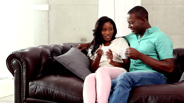 Couple having coffee on the couch