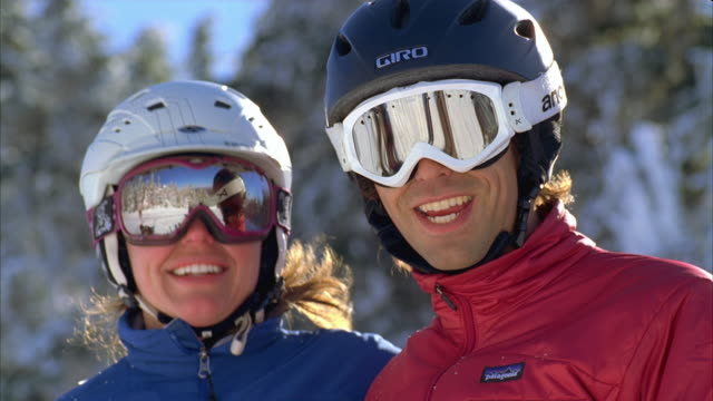 cu couple having fun and smiling in snow / rangeley, maine, usa - winter sport stock videos & royalty-free footage